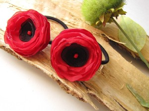 http://www.luulla.com/product/19181/ponytail-holders-with-handmade-fabric-flowers-set-of-2-pcs---red-poppies