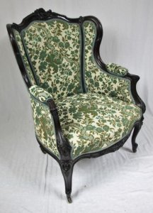 http://www.sellingantiques.co.uk/171485/upholstered-carved-mahogany-rococo-armchair/